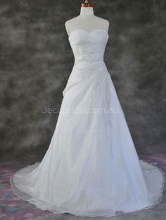 This organza A-line wedding dress features crisscross bust with beaded lace embellishments adorned. Complete with zip closure.