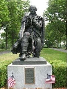 George Washington Kneeling in Prayer by Donald DeLue erected in commemoration of the 50th Anniversary of the George Washington Memorial Park Cemetery Association 1939-1989. Found in Paramus, New Jersey, photographed by Michael Herrick.