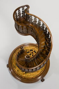 Wooden model of a spiral staircase ; in Various exotic woods. This exquisite model staircase, standing on animal-carved feet with ivory claws and with carved balustrading, is one of the most beautifully constructed and ambitious works of art of its kind. Produced around the time of The Great Exhibition, it may have been produced with such an event in mind.