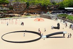 andrew hankin cooks up beach installation with oversized frying pan