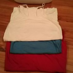 Tank top bundle. Size large. Tank top bundle. Great condition. Perfect for wearing under clothes or to the pool or beach. Nice and light. All have bra supports inside. SO Tops Tank Tops