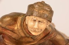 Bronze and Ivory figure of a Russian Cossack sitting on a rock. Overall height 11 inches.