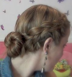 Braided crown into messy bun. You can find the tutorial here
