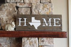 Rustic wooden sign handcrafted from reclaimed wood and hand-painted with the word HOME with a Texas silhouette. It looks great propped up on your