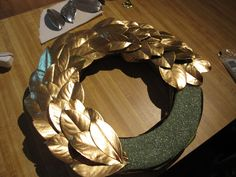 Gold spray painted leaves for Christmas wreath