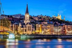 Nighttime cityscape of Lyon, France from the Saone River. - vwalakte/iStockphoto/Getty Images