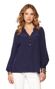 Get ready for a style epiphany: this silk blouse is the secret workhorse of your closet. You can wear this long sleeve silk top tucked in or worn out, sleeves pushed up or blissfully long, styled with a belt over leggings, peeking out from under a blazer, draped over the top of a pencil skirt...Elsa is one shirt with an endless number of looks year-round. This season, we're making Elsa's job a little easier by bringing you bright new prints and colors to spice up your collection.