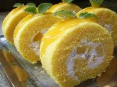 1. Preheat oven to 200c/ 220c(Fan)/ 425F/Gas mark 7 Grease and line a swiss roll tin with baking parchment.  2. Whisk the eggs, sugar and lemon until light and frothy. Sift the flour into the mixture, carefully folding in. Turn the mixture into the tin and gently shake to allow the mixture to settle in all the corners.  3. Bake for 10 mins or until the sponge is golden brown and beginning to shrink from the edges of the tin.  4. Place a piece of parchment slightly bigger than the tin onto a…