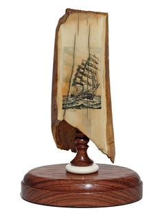 """""""Glory of the Seas"""" Color scrimshaw on ancient walrus tusk ivory artifact by Michael Cohen. Fine depiction of one of the most famous of all the clippers, the Glory of the Seas. This was used as some type of tool or artifact hundreds and hundreds of years past, judging from the scoring marks at the top of the tusk.  Size: 4""""W x 3""""D x 6 1/4""""H Price: $750.00 -- on ScrimshawGallery.com #scrimshaw"""