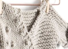 Learn how to make this knitted kimono Jacket for babies using Pop Corn Stitches.