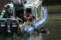 A Chicago Police Department rescue diver prepares to exit the water after searching the Chicago River along with divers from the Chicago Fire Department for a possible body in the water at the Diversey bridge in Chicago. The search was called off after divers were unable to find anyone.