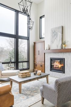The cool grey tones of Splendours Grey ceramic subway tile provide a perfect contrast to the warm fireplace. This luxurious and cozy living… Cabin Fireplace, Small Fireplace, White Fireplace, Rustic Fireplaces, Fireplace Remodel, Fireplace Surrounds, Fireplace Design, Fireplace Ideas, Fireplace Facade