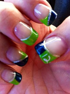 Love the way each nail is different....not a seattle fan lol but love the colors together
