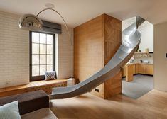 The two floors of this Kiev apartment are connected by a long slide