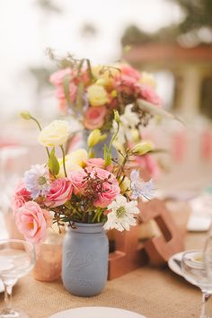 blue painted mason jar florals http://www.weddingchicks.com/2013/09/20/vintage-destination-wedding/