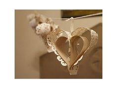 Punched Paper Heart Bunting - lining paper and brown paper garland Paper Heart Garland, Craft Kits, Craft Ideas, Folded Book Art, Paper Decorations, Wedding Decorations, Paper Hearts, Handmade Wedding, Be My Valentine