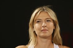 Russian tennis player Maria Sharapova answers journalists' questions after an exhibition tennis match in Malakoff, a suburb of Paris, on May 23, 2013, three days ahead of the beginning of French Tennis Open Roland Garros 2013 at the Roland Garros stadium in Paris