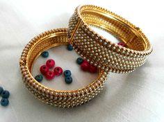 Royal Pearl bracelets in Golden finish only for Rs 2199 - Free Shipping.  Visit http://www.flea91.com/Bracelet/Pearl-Bracelet-Bangles-id-654835.html