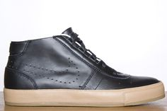 Rare Nike black leather and tan rubber lining! Nice foot walks, A pair I would add to my shoe collection any day.  http://www.spasandstuff.com/