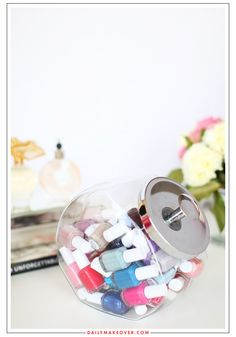 You can also use a large candy jar to keep all your polishes together. This one easily holds 60 bottles.