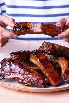 Brandy and hoisin shine in these sweet and sticky pork spareribs, a staple at most dim sum restaurants.cut the sugar down to 1 cup Rib Recipes, Grilling Recipes, Asian Recipes, Cooking Recipes, Smoker Recipes, Asian Foods, Cooking Tips, Pork Spare Ribs, Pork Ribs