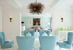 I love the soft turquoise-color chairs.