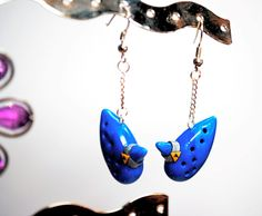 Hey, I found this really awesome Etsy listing at https://www.etsy.com/listing/83341481/legend-of-zelda-ocarina-of-time-earrings