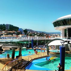 Even port days can be pool days. Take an early swim on Explorer of the Seas for incredible coastline views of cities like Vigo, Spain.