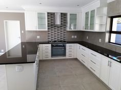 Satin white painted kitchen with Rustenburg granite tops. Featuring glass cutouts with glass inserts. The design is clean yet elegant and will still be on trend for years to come. Kitchen Tops, Granite Kitchen, White Kitchen Cabinets, Kitchen Pantry, Interior Ideas, Interior Design, Granite Tops, Pantries, Cabinet Doors