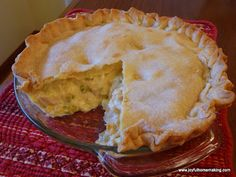 Easy Chicken Pot Pie 2 pie crusts 8 oz sour cream 1 16 oz can mixed vegetables (like Veg-all well drained) 1 can cream of chicken soup (don't add water) 2 or 3 cooked, chopped chicken breasts 350 for 45 min