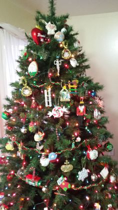 My Christmas Memory Tree Decorated wiith all Christmas ornaments that was saved through the years of my precious children.