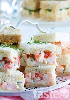 Tarragon Prawn Tea Sandwiches _ Go gourmet with these dainty squares filled with creamy herbed prawns! Tea Party Sandwiches, Finger Sandwiches, Shrimp Sandwich, High Tea Food, Afternoon Tea Parties, Snacks Für Party, Party Hats, Tea Recipes, Gastronomia