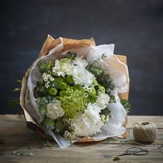Natural Elegance Green & White Bouquet of Flowers