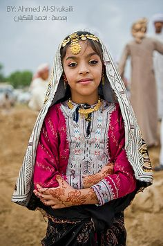 Oman | Girl wearing traditional Omani dress for the Sharqiah Region. In Oman most of the region have their own traditional dress.  | © Ahmed Al-Shukaili