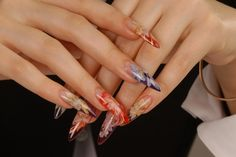 Shape And Long Floral Nail Design.