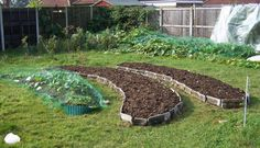 raised beds with recycled roof tiles