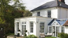 This traditional orangery design is relatively rare today, as the modern timber structures have tended to predominate. But this is quintessentially what orangeries are all about. It has large vertical sliding sash windows set into solid walls with a flat roof and a glass lantern. #RoofingIdeas #FlatRoofRepairDIY