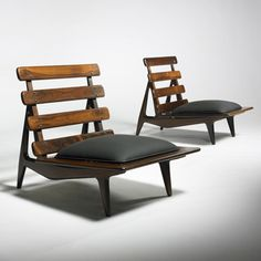 Lot 435: Sergio Rodrigues. lounge chairs, pair. c. 1954, rosewood, upholstery. 25¾ w x 35 d x 28¼ h in. result: $9,600. estimate: $10,000–15,000.