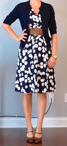 Navy & white polka-dot dress, navy cardigan, wide woven belt.