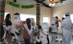 halloween party games for kids mummy wrap