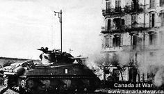 A Canadian Sherman tank from the Eight Army is seen in action on a street in Ortona, Italy during eight days of fighting to win the town.