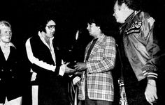 Receiving a plaque from RCA , June 26, 1977, Elvis with his father, Vernon Presley.