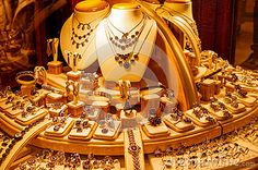 Display of golden jewellery in a shop or store window.