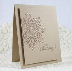 handmade Christmas greeting card ... clean and simple ... kraft with brown inking  and white gel pen accents ... large feathery snowflake off-the-edge ... lovely!