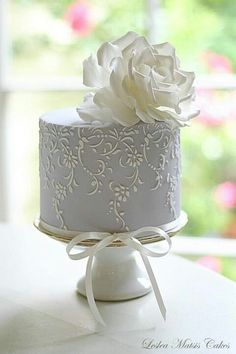 White and Blue Rose Stenciled Cake by Leslea Matsis Cakes