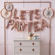 "This letter and number balloons are great for making fashionable decorations at any celebration, and it matches perfectly with the rest of the letter balloons range in other colors. The balloons have a self-sealing valve. Each balloon is supplied flat packed. Coming in a set of the following phrase:LETS PAR TEA *Size of the balloons 16"" in Rose Gold, Gold and Silver - AIR FILL ONLY.String or ribbon included in the sale.Straw for easy inflation by mouth is included in the sale.Balloons come…"