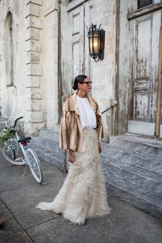 True glamour is most effective when it's without too much fuss and effort. For how to execute the ultimate high-low mix, Jenna Lyons inspires best. A white tee is the quintessential basic, and the ideal piece for subduing a maxi skirt that might normally be reserved for evening affairs. - HarpersBAZAAR.com