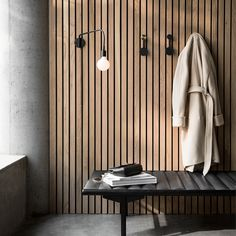 The Small Afteroom Coat Hanger by Menu goes to show that sometimes less is more. A minimalist and versatile design, this coat hanger has two distinct dots of differing sizes from which you can hang your coat, umbrella, or whatever else you can think of. Wood Slat Wall, Wood Slats, Wooden Walls, Interior Desing, Interior Architecture, Spa Interior, Futuristic Architecture, Grey Hallway, Fusion Design