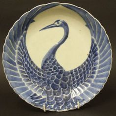 An Century Japanese Porcelain Dish from the Arita Kilns. The Dish has Moulded Relief Decoration in the Form of a Crane with Outstretched Wings Which is Decorated in Blue and White. For a very similar century Japanese porcelain dish but decorated Porcelain Ceramics, Ceramic Pottery, Pottery Art, Ceramic Art, Ceramic Plates, Slab Pottery, Porcelain Doll, Fine Porcelain, Thrown Pottery
