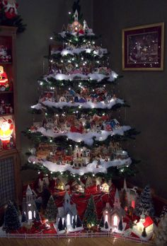"I took a hinged 7' tree and took every other section out to create the ""platform"" to display my Vintage Putz collection."